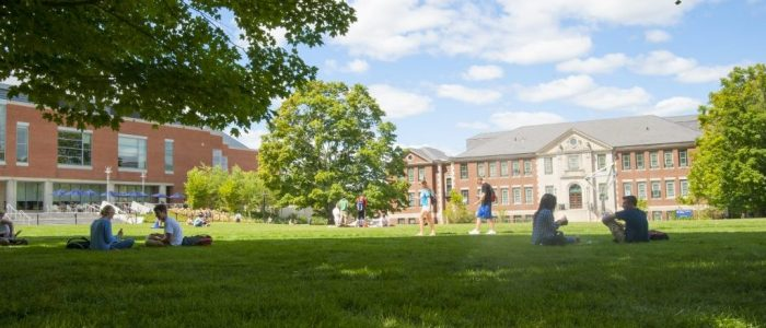 Students walking across the Student Union Mall with the Castleman (Engineering) Building in the background on Aug. 29, 2014. (Sean Flynn/UConn Photo)